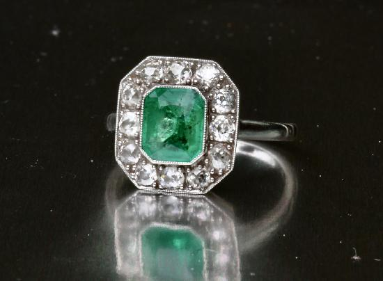 ANTIQUE EMERALD AND DIAMOND ENGAGEMENT RING.