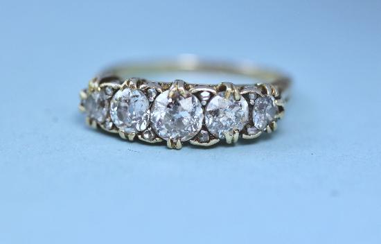 ANTIQUE FIVE STONE DIAMOND ENGAGEMENT RING