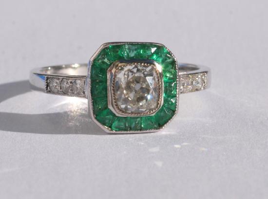 ART DECO EMERALD AND DIAMOND ENGAGEMENT RING.