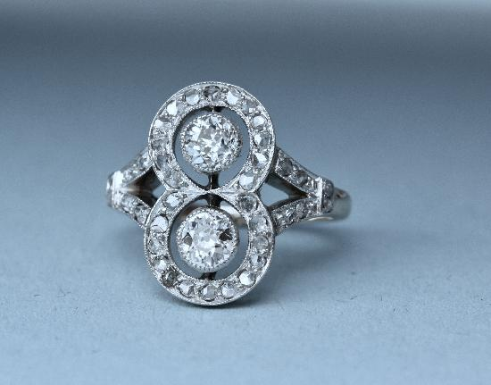 CONTINENTAL ANTIQUE DOUBLE DIAMOND ENGAGEMENT RING