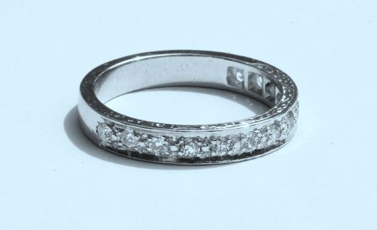 DIAMOND HALF ETERNITY RING.