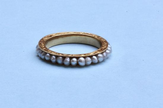 EDWARDIAN GOLD AND SEED PEARL FULL ETERNITY RING