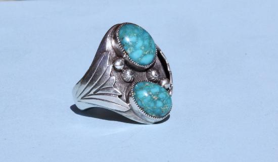 LARGE NAVARRO INDIAN SILVER AND TURQUOISE RING.