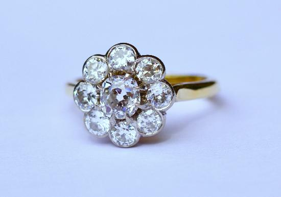 OLD-CUT DIAMOND DAISY CLUSTER ENGAGEMENT RING