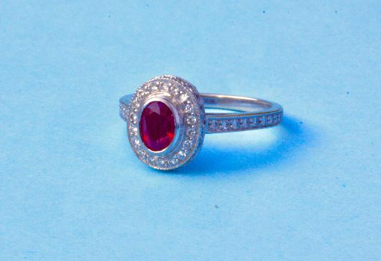 PRETTY RUBY AND DIAMOND CLUSTER ENGAGEMENT RING