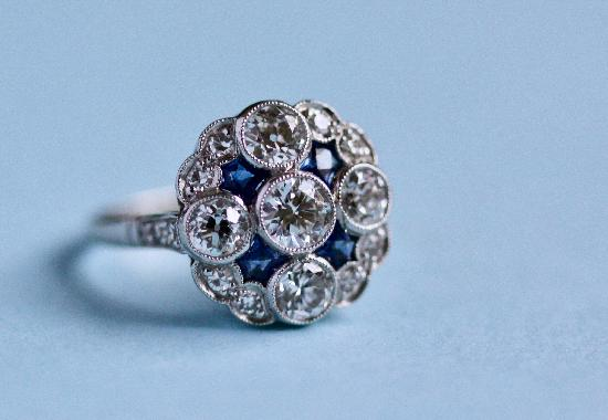 SAPPHIRE AND DIAMOND CLUSTER ENGAGEMENT RING.