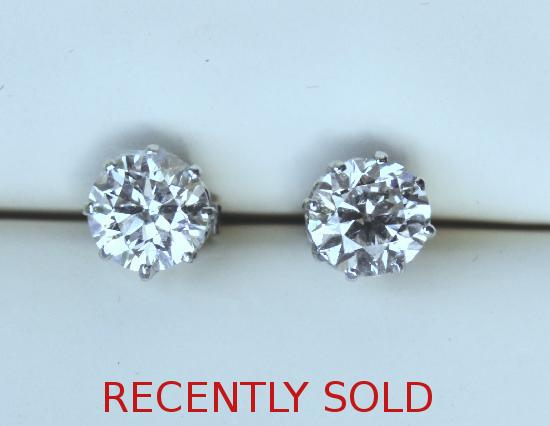 HUGE DIAMOND STUD EARRINGS.