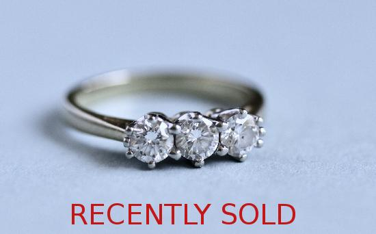 PRETTY DIAMOND THREE STONE ENGAGEMENT RING