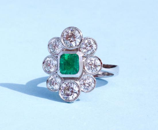 STUNNING EMERALD AND DIAMOND ENGAGEMENT RING