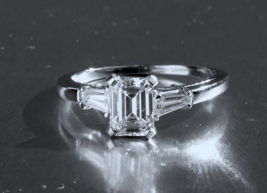 STUNNING EMERALD CUT DIAMOND ENGAGEMENT RING. G COLOUR