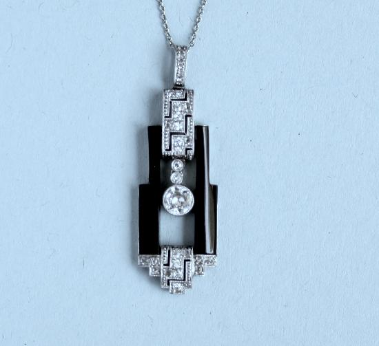 STYLISH ART DECO ONYX AND DIAMOND PENDANT