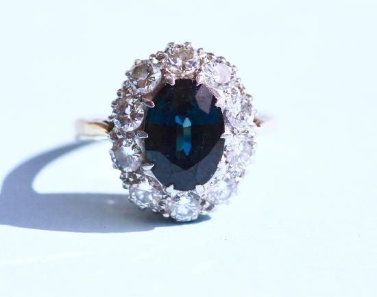 VINTAGE SAPPHIRE AND DIAMOND CLUSTER ENGAGEMENT RING