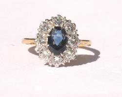 Sapphire And Diamond Cluster Engagement Ring.   Vintage