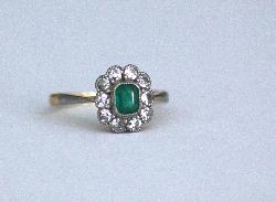 Antique Emerald And Diamond Cluster Engagement Ring
