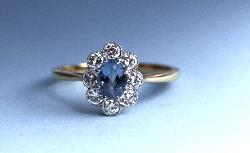 Aquamarine And Diamond Daisy Cluster Engagement Ring